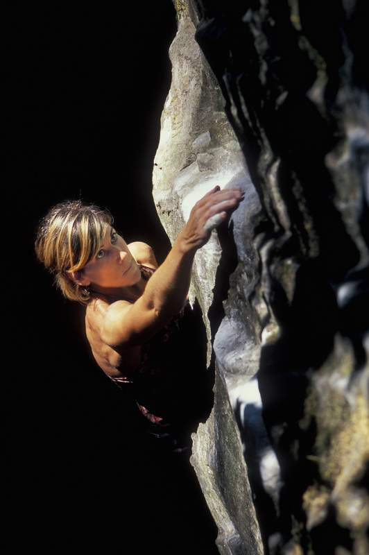 Stong, multi-talented woman climbs rock, Carver, Oregon