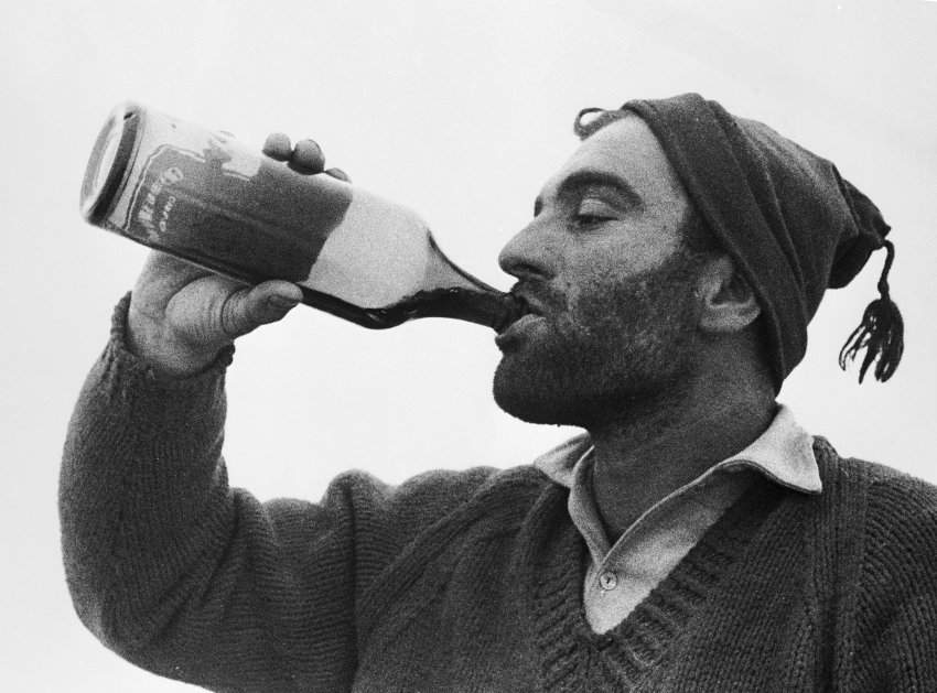 20th March 1963: Italian mountaineer Cesare Maestri, known locally as 'The Spider of the Dolomites', stops for a refreshing drink of mineral water on his way up the Lavarado 'Death Peak', in Northern Italy. (Photo by Keystone Features/Getty Images)