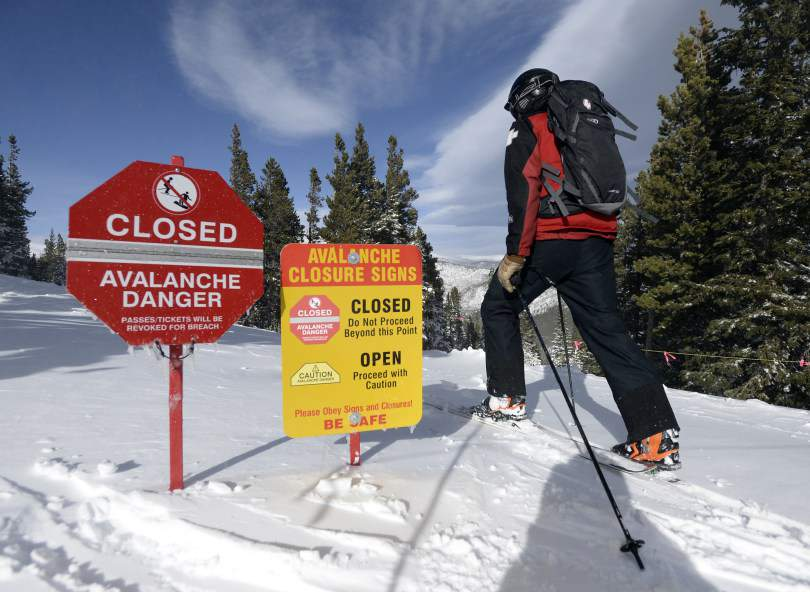 Avalanche003.JPG Eldora Mountain Resort Ski Patrol Director Travis Brock skis past an avalanche danger sign near the Moose Glades while heading out to do avalanche mitigation with the rest of his team on Wednesday, Dec. 24, at Eldora Mountain Resort in Boulder County. Jeremy Papasso/ Camera