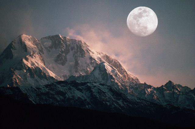 April 1984, Pakistan --- Full Moon Above Tirich Mir --- Image by © Brian A. Vikander/CORBIS